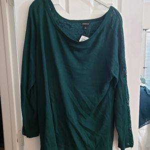 Green sweater with lace details